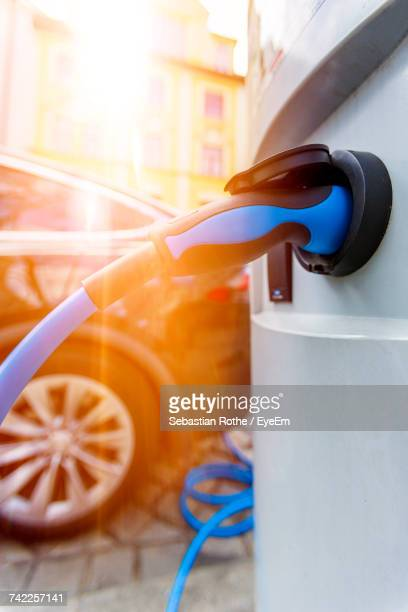 close-up of electric car charging at station - electric vehicle charging station stock photos and pictures