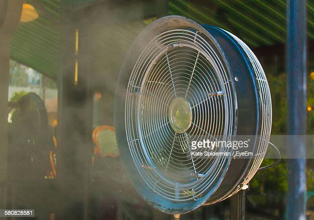 Close-Up Of Electric Fan At Restaurant Patio