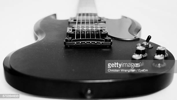 Close-Up Of Electric Guitar Against White Background