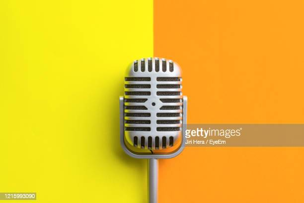 close-up of electric lamp against yellow background - micro photos et images de collection