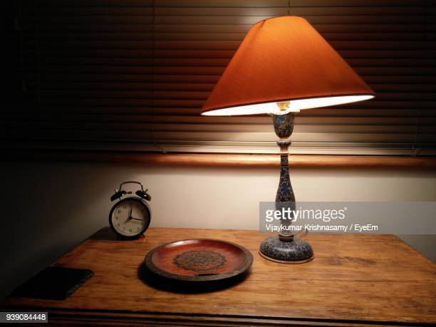 close-up of electric lamp on table at home - lamp stock-fotos und bilder
