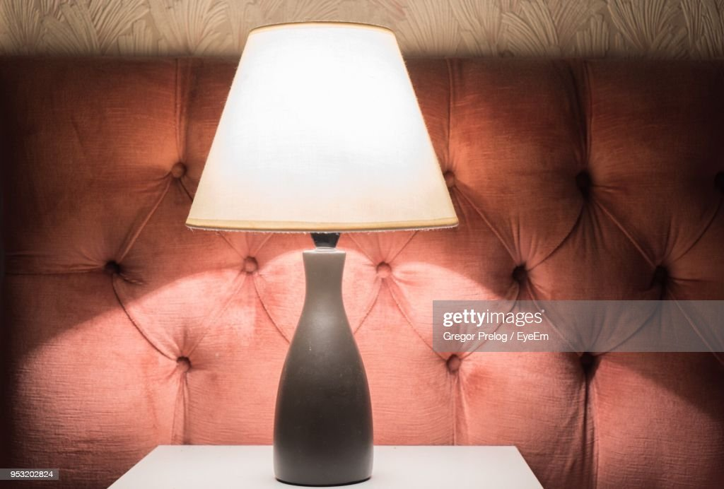 Close-Up Of Electric Lamp On Table At Home : Stock Photo