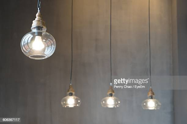 Close-Up Of Electric Light Hanging In Building