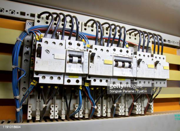 close-up of electric switchboard at factory - electrical panel box stock pictures, royalty-free photos & images