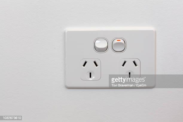 Close-Up Of Electrical Outlet On Wall