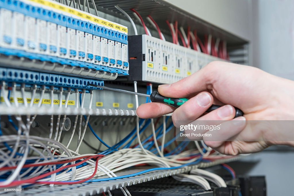 Close-up of electrician installing cable in distribution fusebox, Munich, Bavaria, Germany : Stock Photo