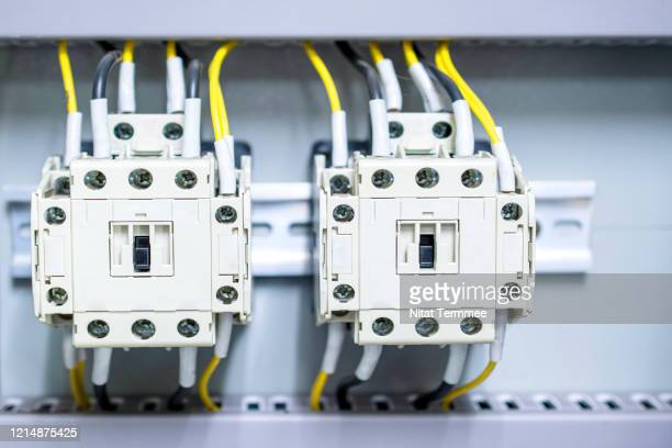 close-up of electricity distribution box with wires and circuit breakers in control room. - power supply stock pictures, royalty-free photos & images