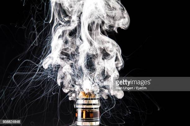 Close-Up Of Electronic Cigarette Against Black Background