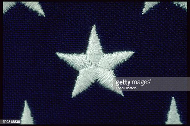 close-up of embroidered star on flag - gipstein stock pictures, royalty-free photos & images