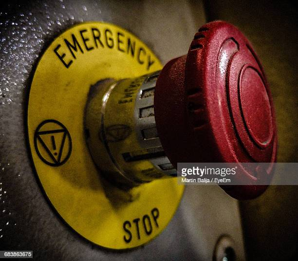 Close-Up Of Emergency Stop Button On Metal
