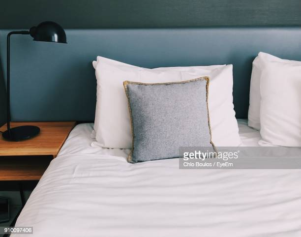 close-up of empty bed at home - pillow stock pictures, royalty-free photos & images