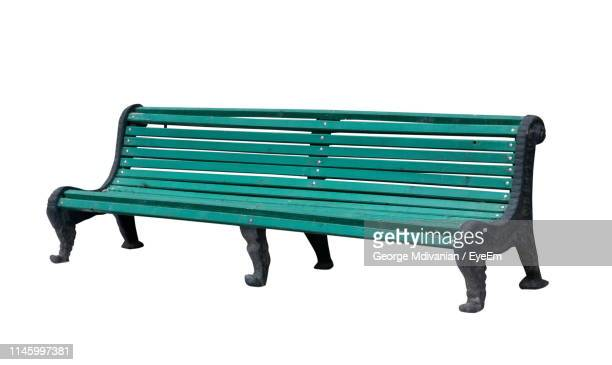 close-up of empty bench against white background - ベンチ ストックフォトと画像