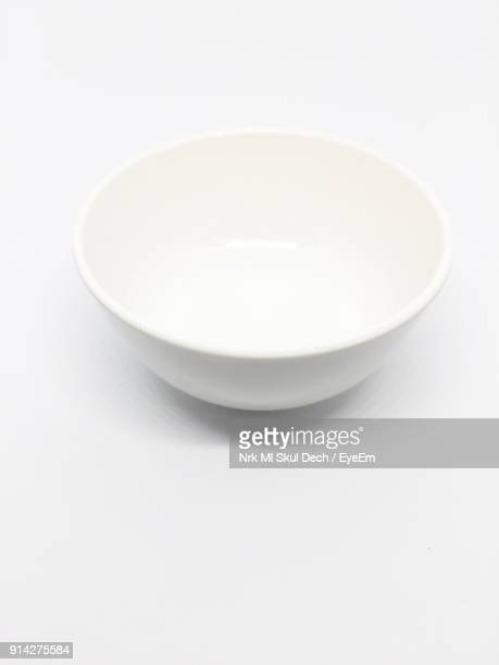 close-up of empty bowl against white background - bowl stock pictures, royalty-free photos & images