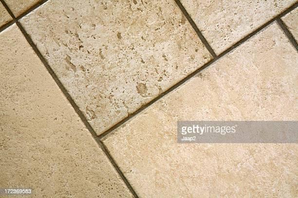 Close-up of empty ceramic Italian floor tiles, diagonal