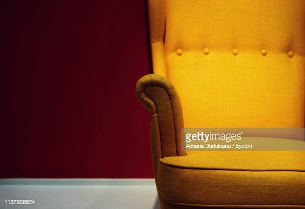 close-up of empty chair at home - 肘掛け椅子 ストックフォトと画像