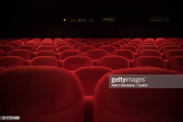 close-up of empty chairs in auditorium - seat stock pictures, royalty-free photos & images