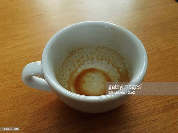 Close-Up Of Empty Coffee Cup On Table
