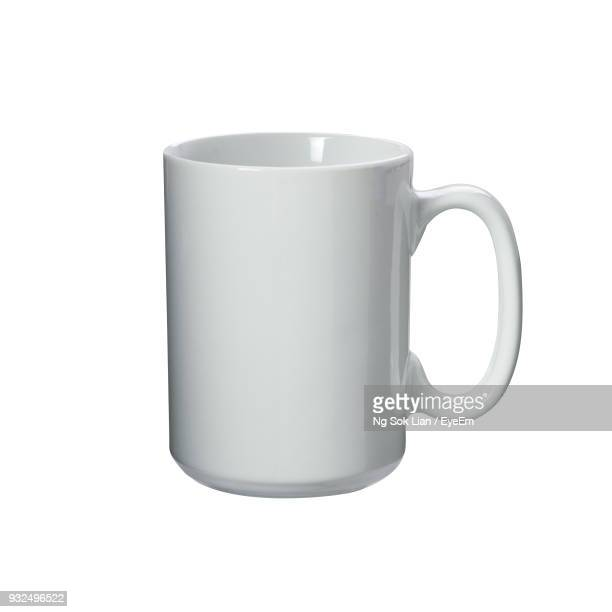 Close-Up Of Empty Cup Against White Background