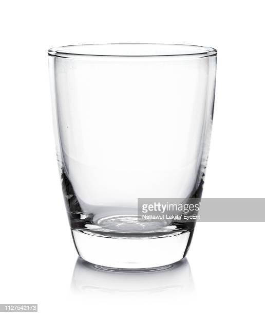 close-up of empty drinking glass against white background - drinking glass stock pictures, royalty-free photos & images