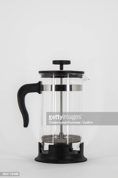 Close-Up Of Empty French Press Against White Background