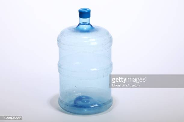 Close-Up Of Empty Gallon Over White Background