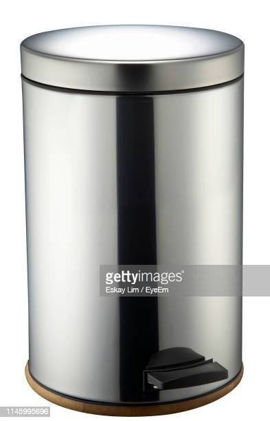 close-up of empty garbage bin against white background - bin stock pictures, royalty-free photos & images