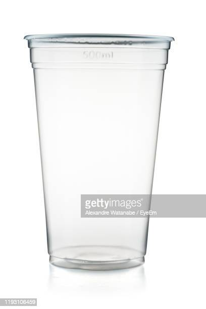 close-up of empty glass against white background - disposable cup stock pictures, royalty-free photos & images
