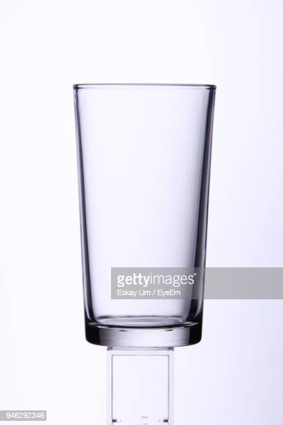 close-up of empty glass against white background - ガラス ストックフォトと画像