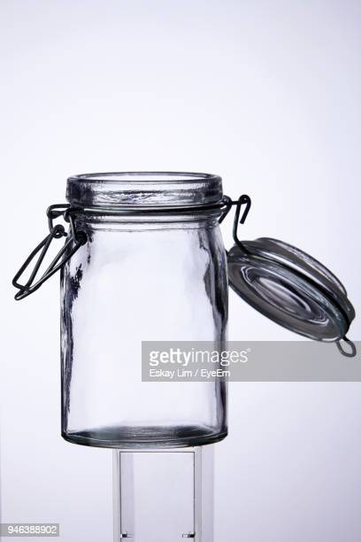 Close-Up Of Empty Glass Jar Against White Background