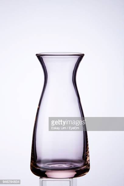 close-up of empty glass vase against white background - 花瓶 ストックフォトと画像