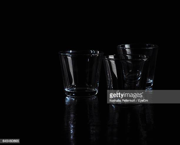 close-up of empty glasses on black background - nathalie pellenkoft stock pictures, royalty-free photos & images