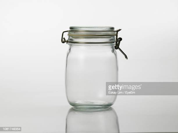 close-up of empty jar on white background - jar stock pictures, royalty-free photos & images