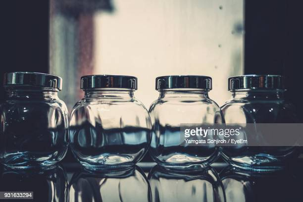 Close-Up Of Empty Jars On Table