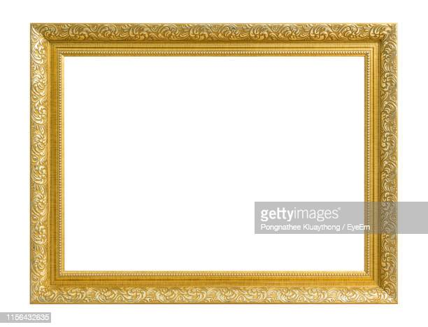 close-up of empty picture frame against white background - picture frame stock pictures, royalty-free photos & images