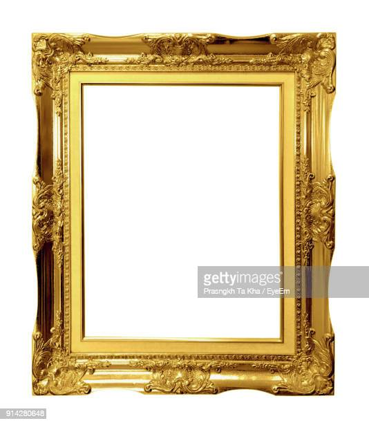 Close-Up Of Empty Picture Frame Against White Background