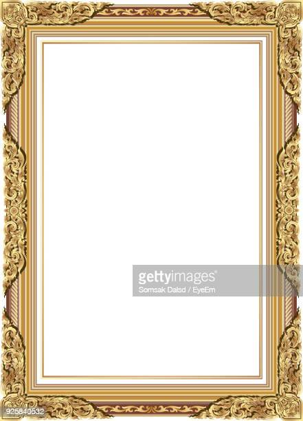 close-up of empty picture frame over white background - koningschap stockfoto's en -beelden