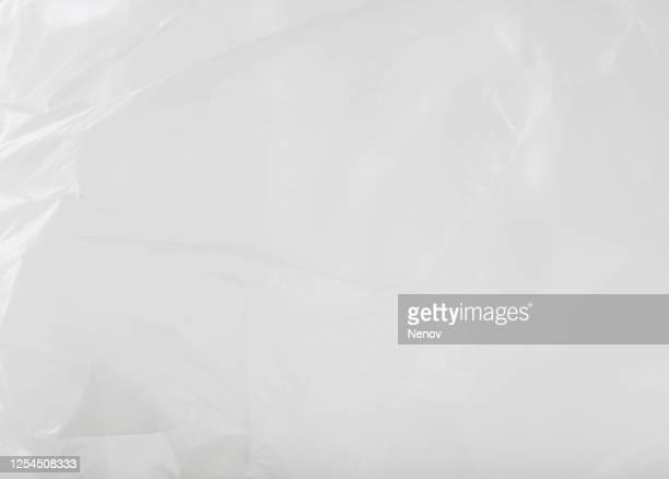 close-up of empty plastic bag background - völlig lichtdurchlässig stock-fotos und bilder