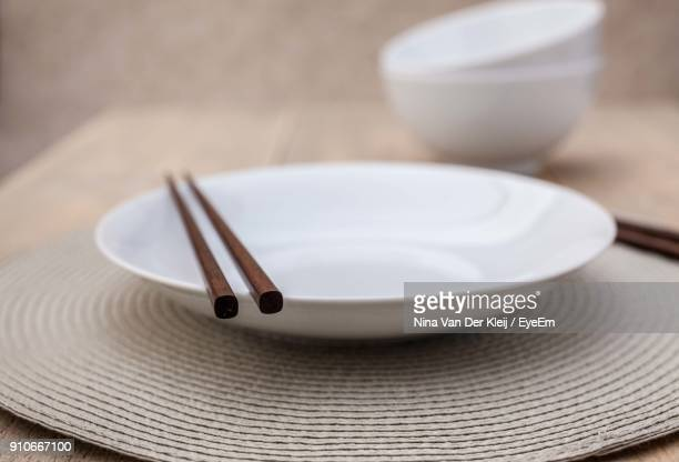 close-up of empty plate on table - chopsticks stock pictures, royalty-free photos & images