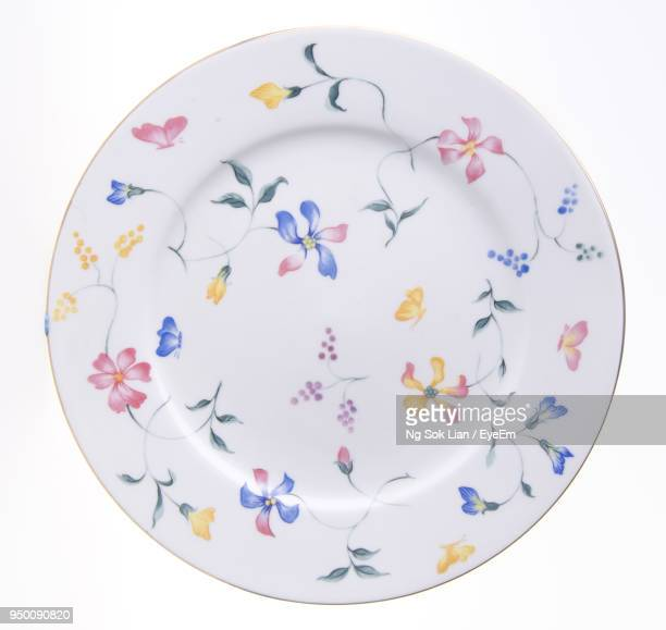Close-Up Of Empty Plate On White Background