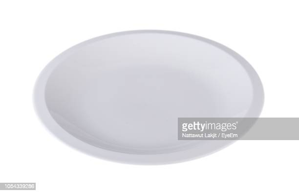 Close-Up Of Empty Plate Over White Background