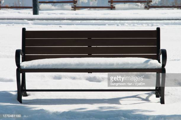 close-up of empty seat in snow - gwangju stock pictures, royalty-free photos & images