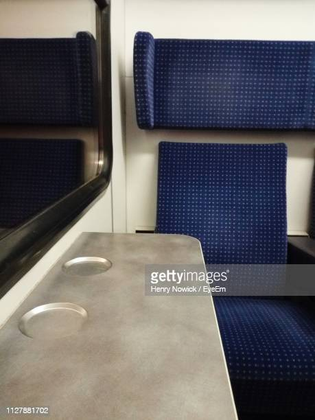 close-up of empty seat in train - train interior stock pictures, royalty-free photos & images