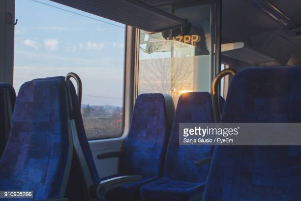 close-up of empty seats in bus - seat stock pictures, royalty-free photos & images