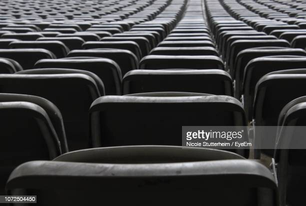 close-up of empty seats in row - stutterheim stock pictures, royalty-free photos & images