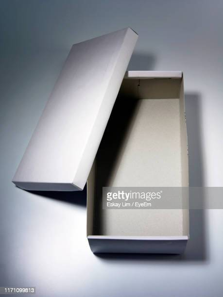 close-up of empty shoe box against white background - shoe box stock pictures, royalty-free photos & images