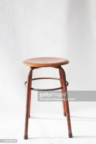 close-up of empty stool against white background - stool stock pictures, royalty-free photos & images