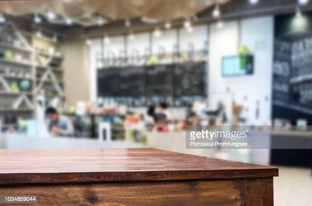 close-up of empty table in restaurant - 背景に人 ストックフォトと画像
