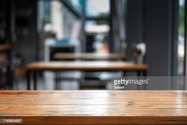 close-up of empty table - wood material stock pictures, royalty-free photos & images