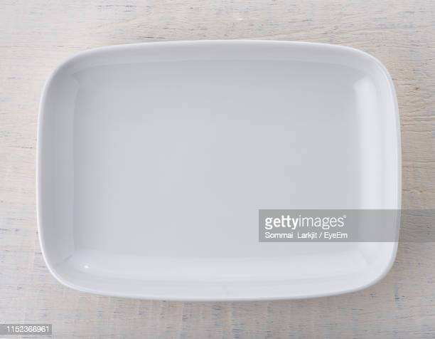close-up of empty tray on table - tray stock pictures, royalty-free photos & images