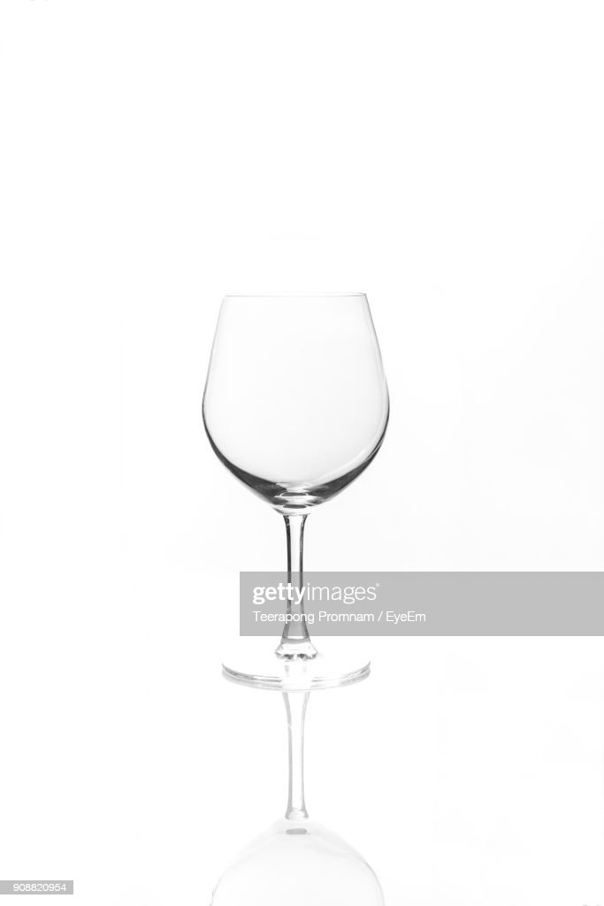 Close-Up Of Empty Wineglass Against White Background : Stock Photo